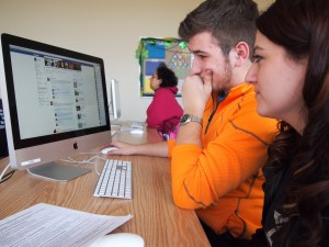 Afton Fonzo, social media editor, and Justin Wahy, multimedia editor, review content requests during a Wood Word editorial meeting. (Photo: Lindsey Wotanis)
