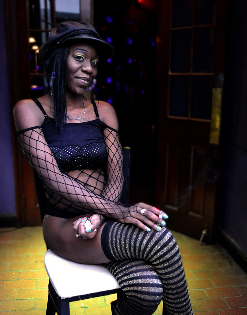 "Danielle Veenstra, College of Central Florida (Rob Marino, adviser) — Keasha Smith, dancer at The Harem, a gentlemen's club, sits outside on her smoke break; both relaxing and enticing new customers. Smith has worked hard her entire life in order to survive and she appreciates attitude and gutsiness when she sees it. The Chicago native lets everyone know that ""No couples are allowed, only single people are welcome."""
