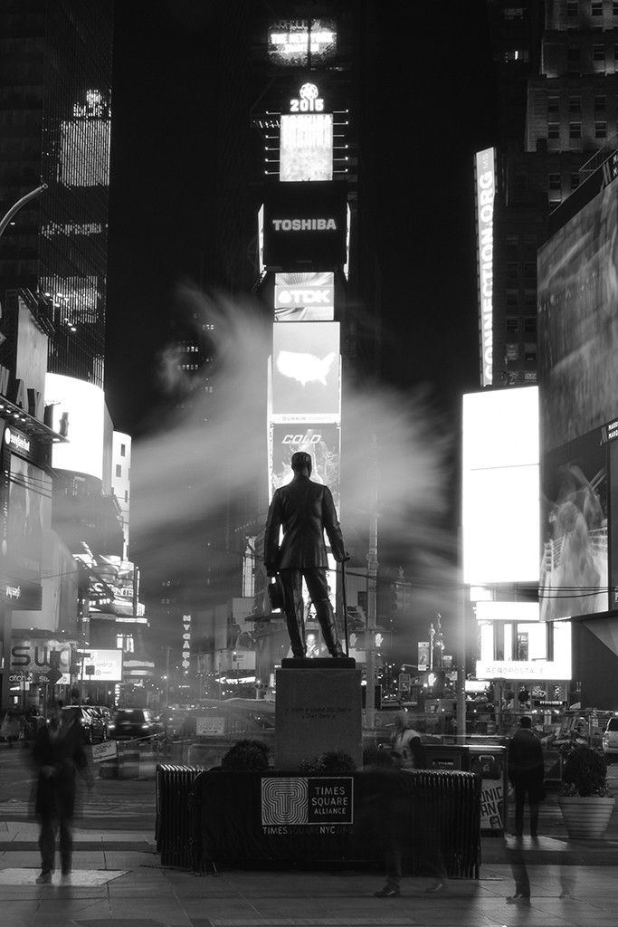 FIRST PLACE, SPRING 2015: Adam Ernesto Fuentes, Mt. San Antonio College (Toni Albertson, adviser) — Commuters and tourists alike trail across a statue of George M. Cohan, the father of American musical comedy.The city lights and subway haze transform Time Square into a Broadway stage.