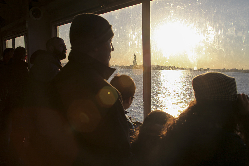 SECOND PLACE: Frank Ladra, San Francisco State University (Rachele Kanigel, adviser) — Passengers of the Staten Island Ferry watch the sun set behind the Statue of Liberty in New York City on Thursday, March 12, 2015. Designed by French artist Frederic Auguste Bartholdi, the statue has been a symbol of freedom since 1886.