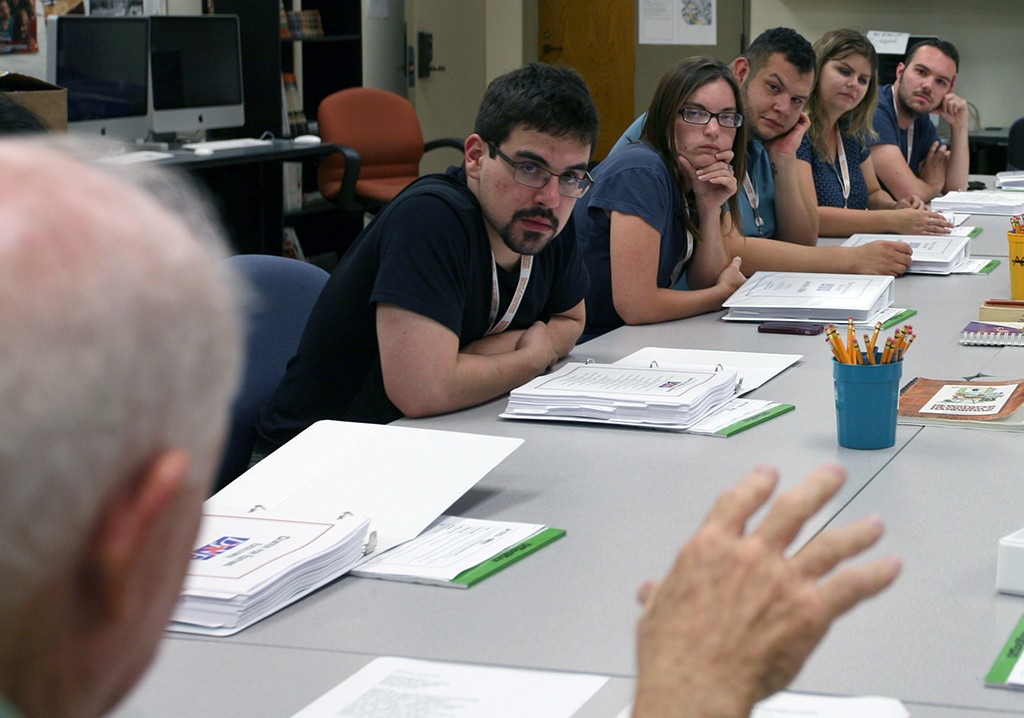 Students in the Dow Jones News Fund Center for Editing Excellence, including Vinny Vella (left), work as part of their internship workshop at the University of Texas. Photo by Bradley WIlson.