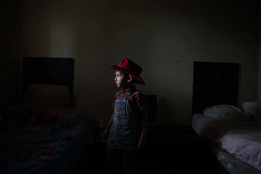 Caiden Contreras, who has autism, stands for a portrait in the room he shares with three of his brothers at his home in San Antonio, Texas, U.S. on May 27, 2015. His parents are both unemployed and living off of his and some of his siblings' disability checks, as well as several other forms of financial assistance from the government. His mother Sandra Contreras homeschools Caiden and four of his seven siblings at their home.