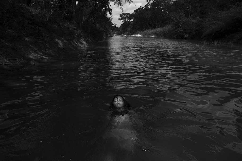 "Serenity Bamberger floats in the Little Blanco River along their property on August 18, 2015 in Blanco, Texas. Three months prior, over Memorial Day, the same river flooded their home and business destroying the majority of the family's belongings and source of income. The Memorial Day weekend flooding, which affected Texas and Oklahoma, killed 24 people according to The Associated Press. Three of those deaths occurred along the Blanco River of which the Little Blanco River is a direct tributary. Despite the toll the river has taken, Bertha Rivera, Serenity's grandmother, said, ""The river bed was dry for years, so now that the water is here I tell the girls to take advantage of it all that they can."""