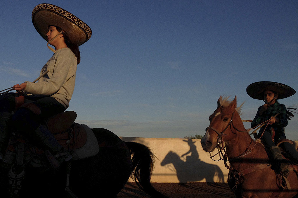 "Caterina Ozuna and Miriam Alejandra Montecillos warm up before practicing their routine for Pre-Estatal at El Rancho Unico in Atascosa, Texas, U.S. on March 26, 2015. ""You feel the nerves the moment you go in,"" Ozuna said."